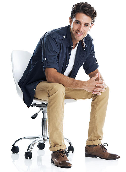 Good Looking Hair Man Sits in Chair and Ponder Demand Generation Marketing